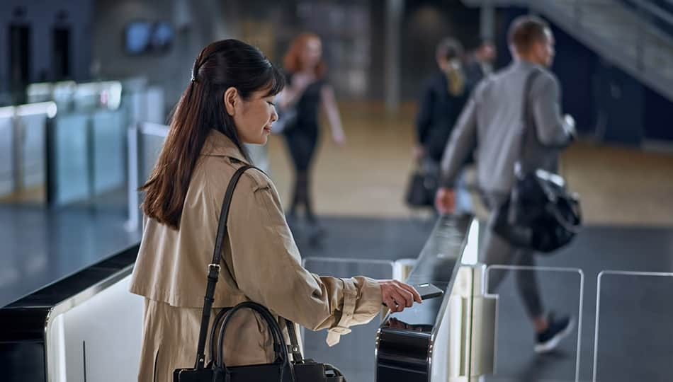 Woman walking through turnstiles