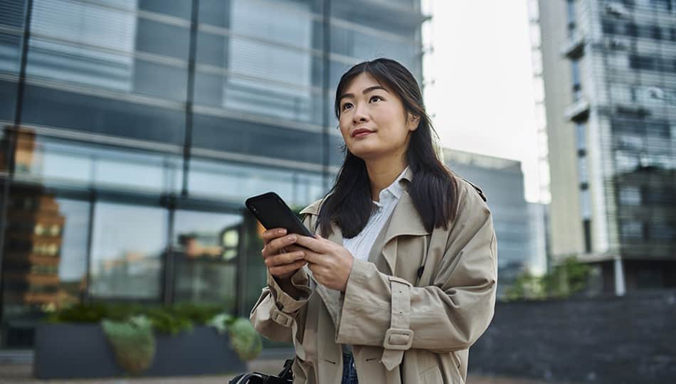 Woman on phone outside the office